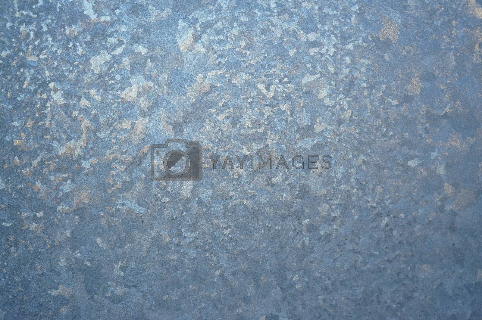 Abstract pattern on a window glass made by frost by Chiffanna