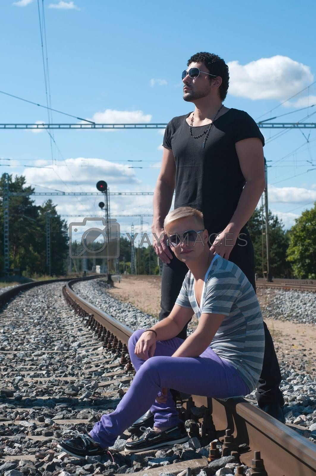 Shot of two young men on train tracks