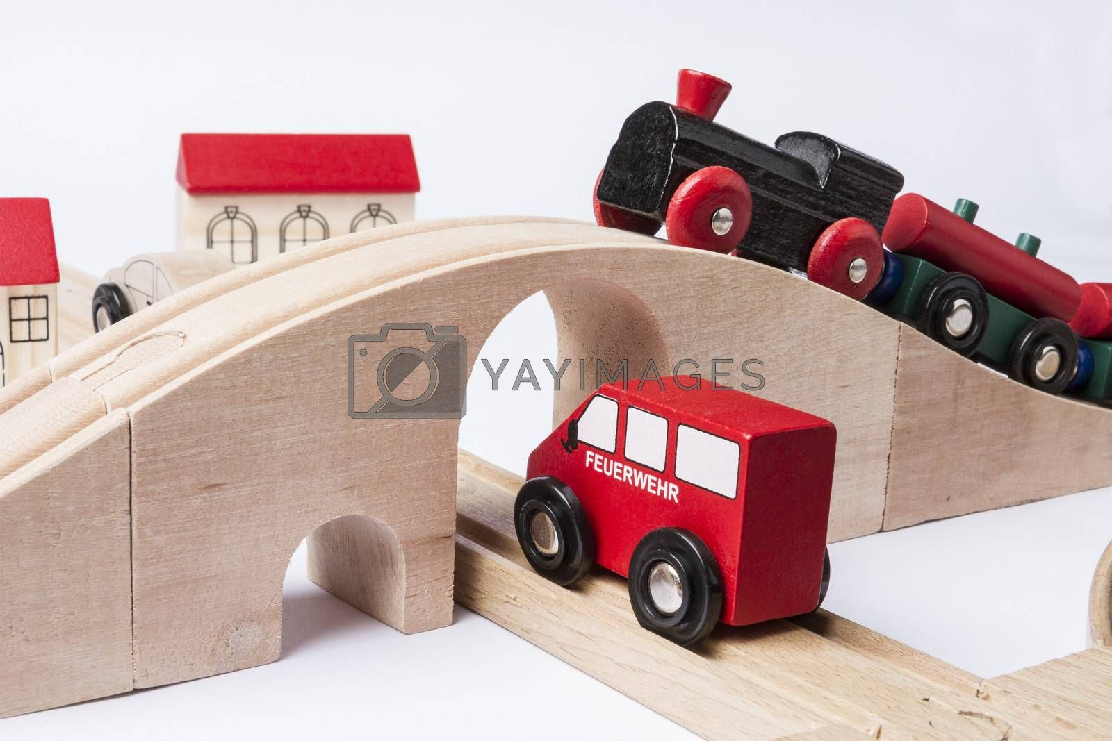 toy traffic with car and train isolated on grey background. horizontal image