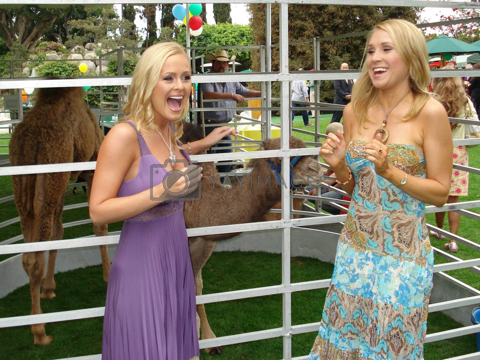 Katie Lohmann and Alana Curry at the Playboy Mansion Easter Egg Hunt. Playboy Mansion, Los Angeles, CA. 04-07-07
