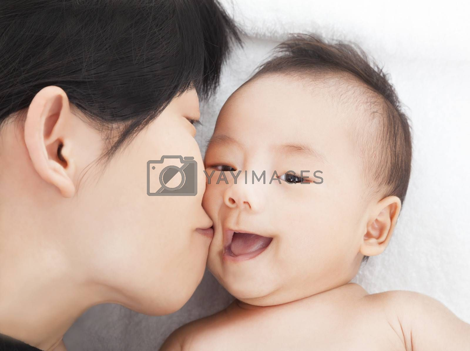 happy asian Mother kiss daughter or son