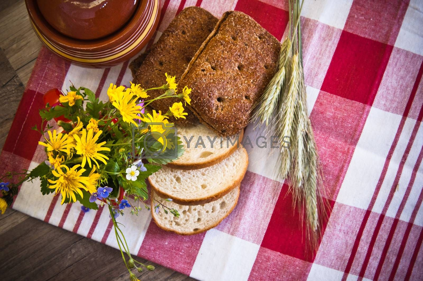 Still life with bread, flowers and pot