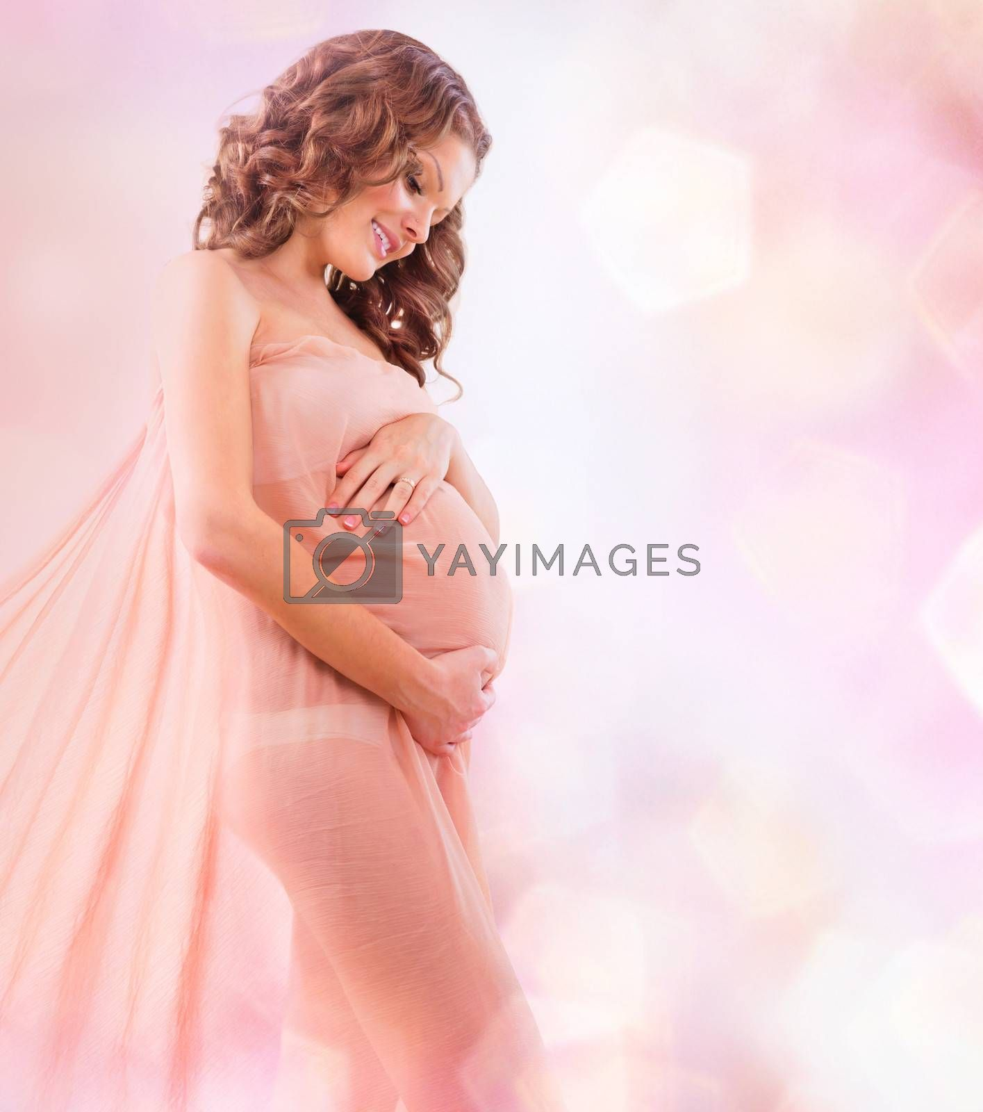 Beauty Pregnant Woman in Blowing Pink Chiffon Shawl