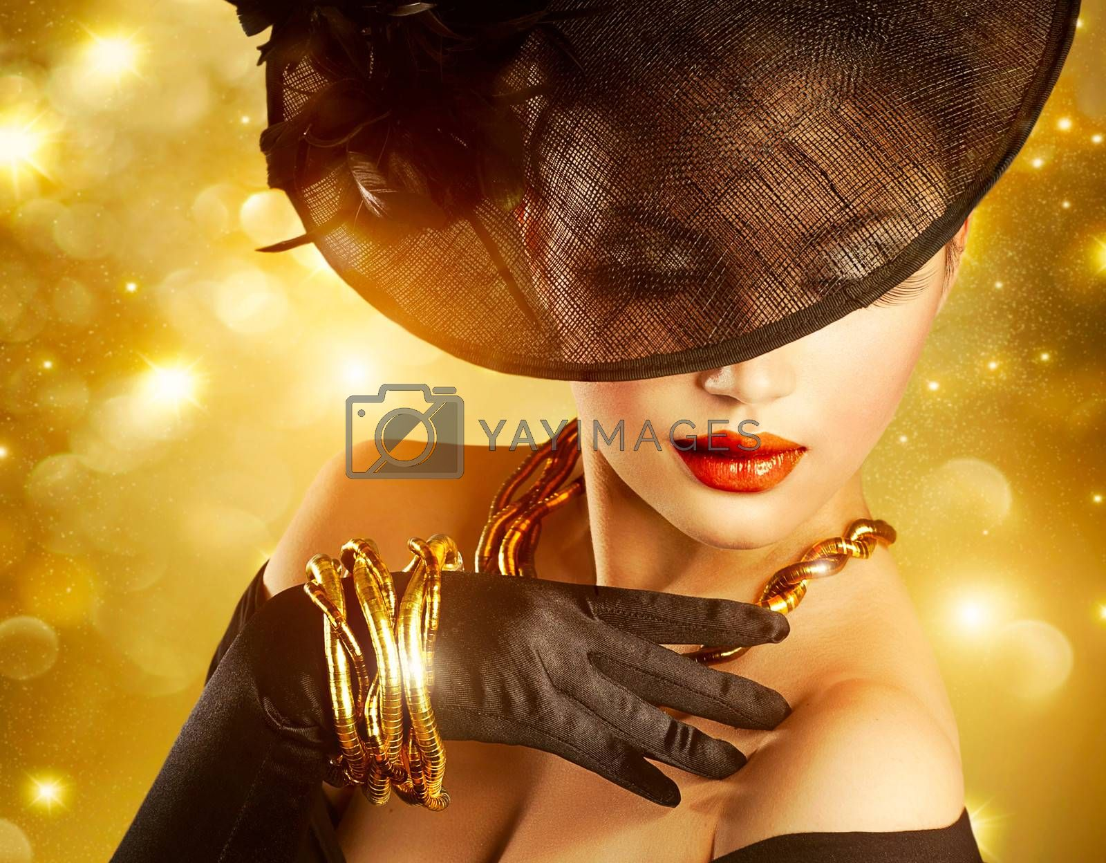 Luxurious Woman over Holiday Golden Background