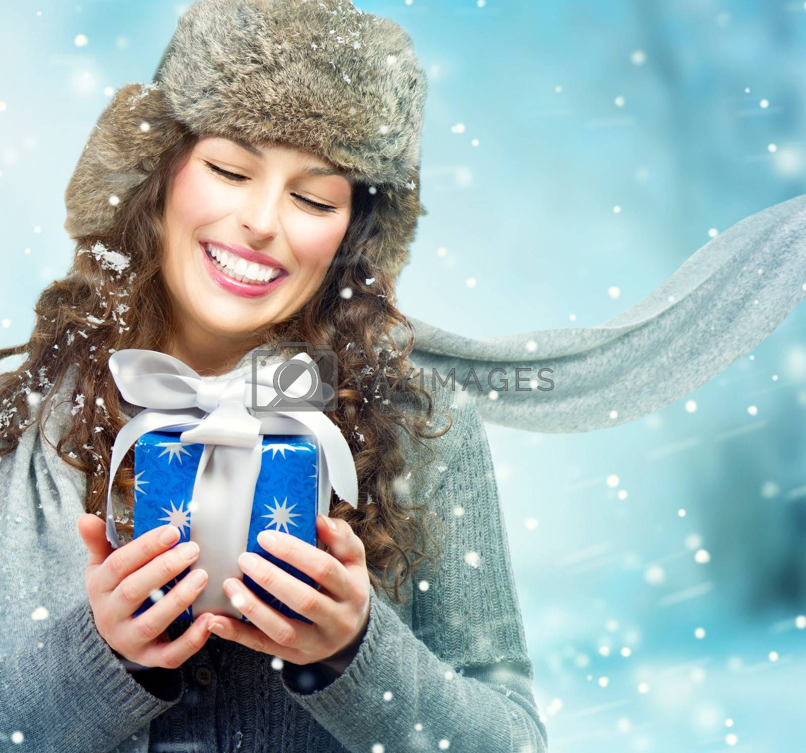 Beautiful Young Woman with Christmas Gift Box. Surprised Girl