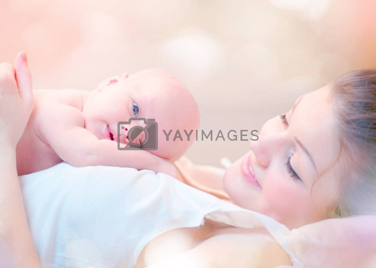 Happy Mother and her Newborn Baby Kissing and hugging