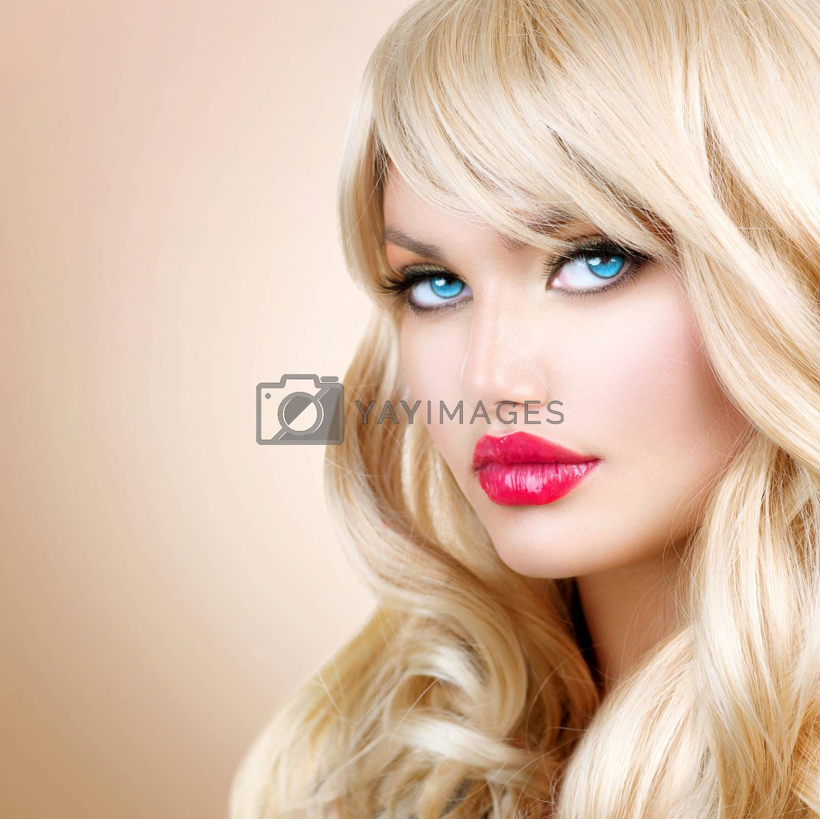 Blonde Woman Portrait. Beautiful Blond Girl with Long Wavy Hair  by Subbotina Anna