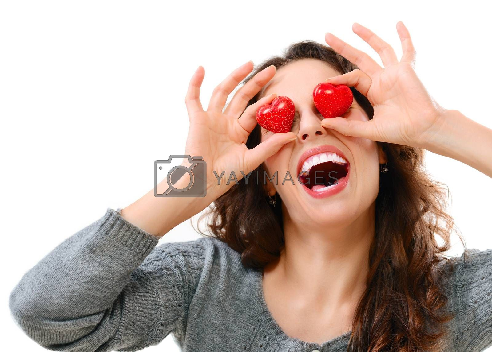 Funny Joyful Girl with Valentine Hearts over her Eyes