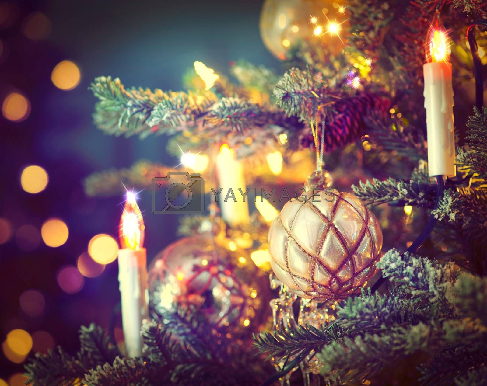 Christmas Tree Decorated with Baubles, Garlands and Candles