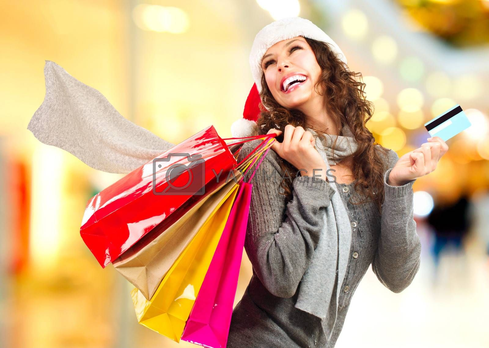 Christmas Shopping. Girl With Credit Card In Shopping Mall