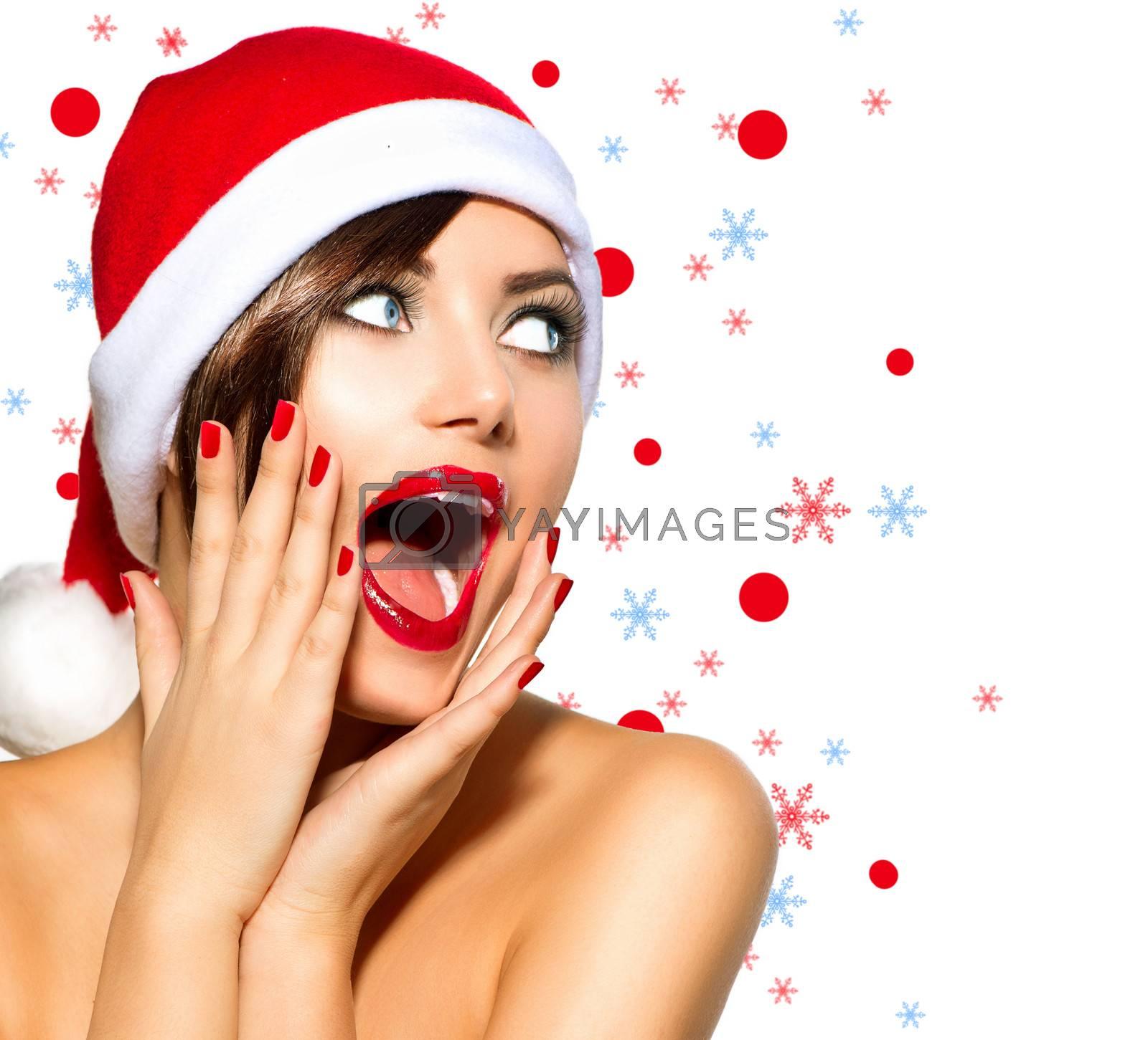 Christmas Woman. Beauty Model Girl in Santa Hat over White