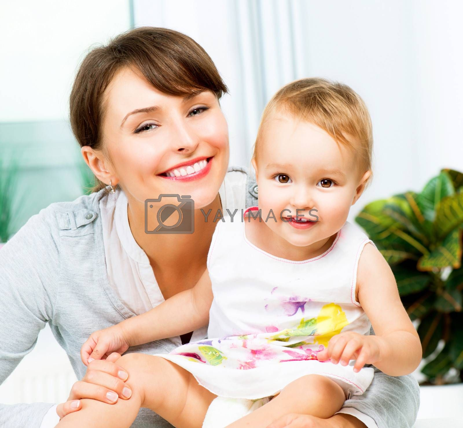 Mother and Baby kissing and hugging at Home