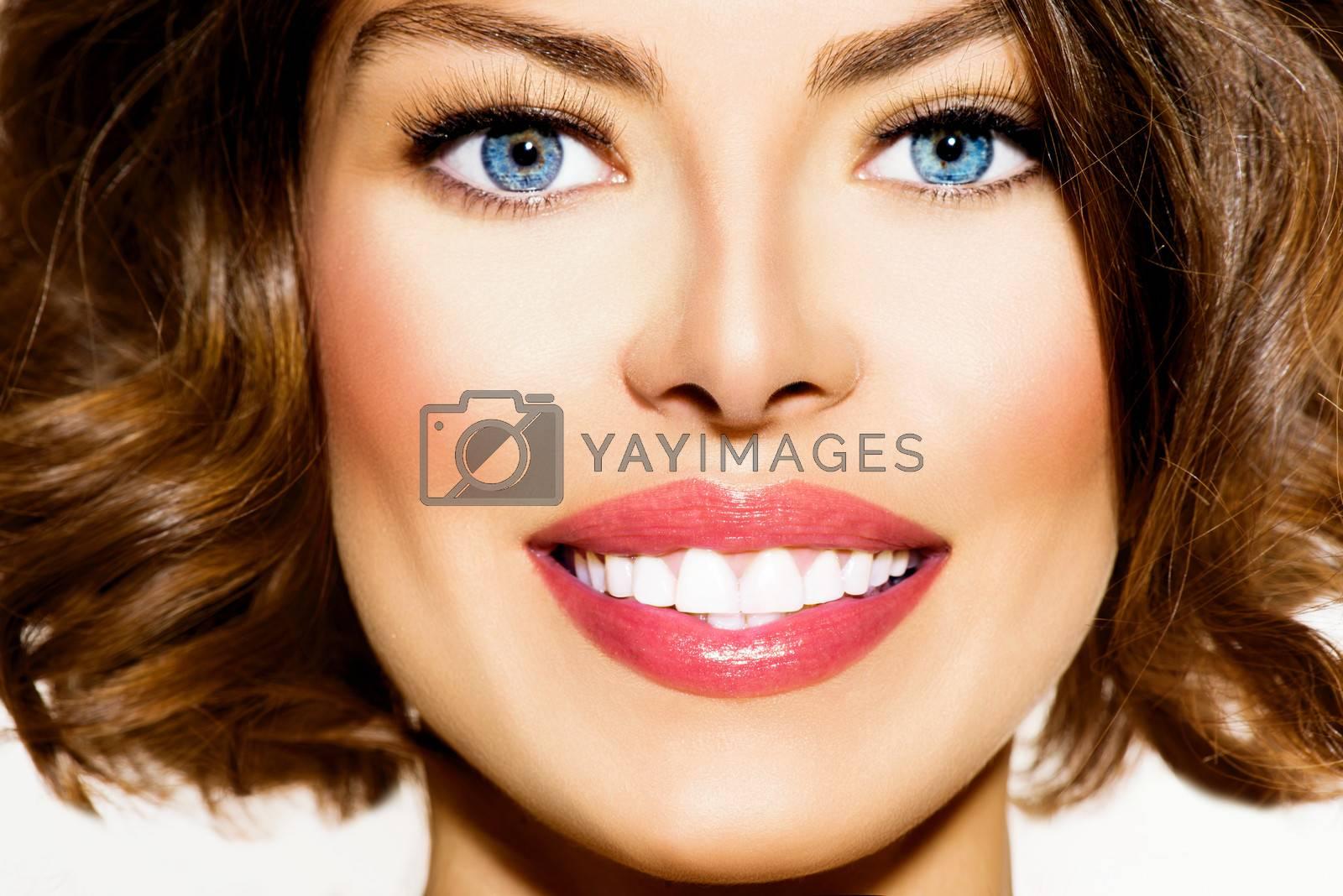 Teeth Whitening. Beautiful Smiling Young Woman Portrait closeup