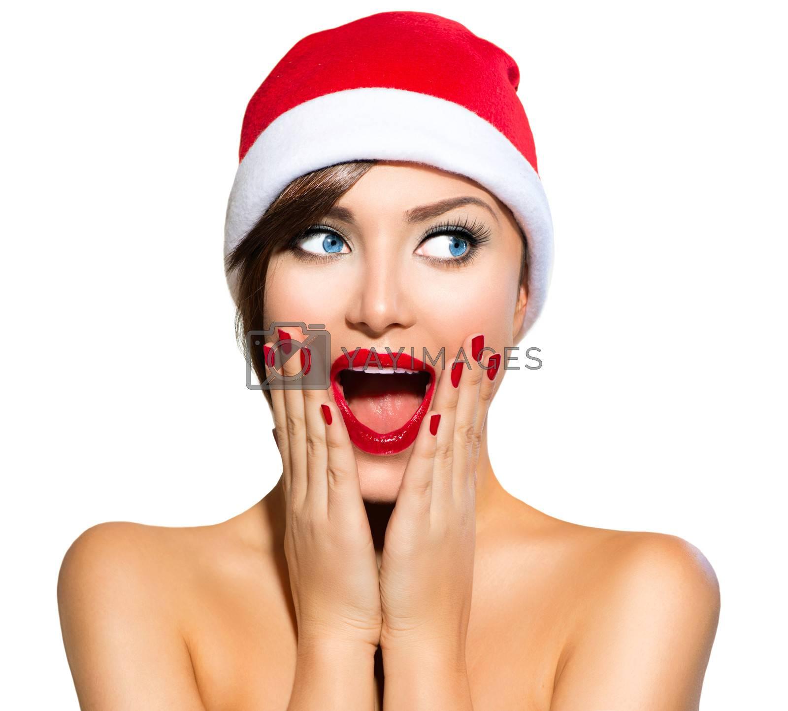 Christmas Woman. Beauty Model Girl in Santa Hat by SubbotinaA