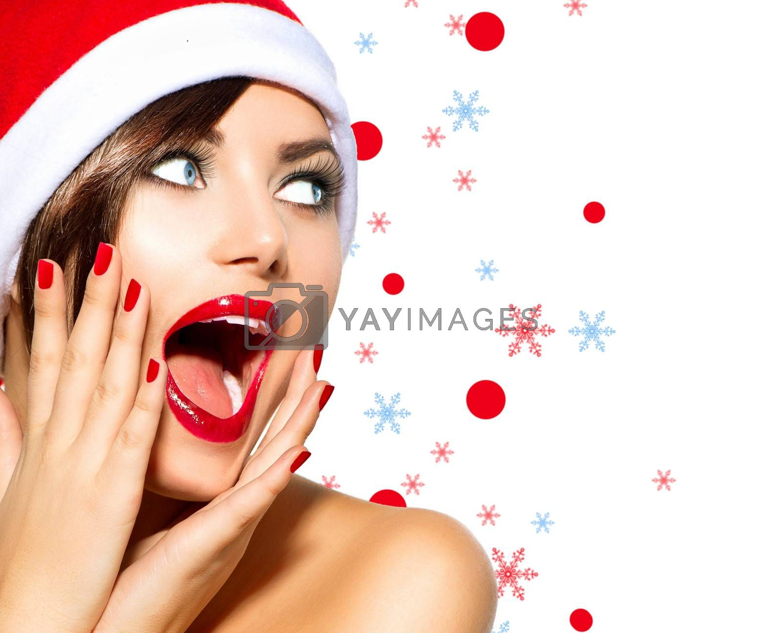 Christmas Woman. Beauty Model Girl in Santa Hat over White by SubbotinaA
