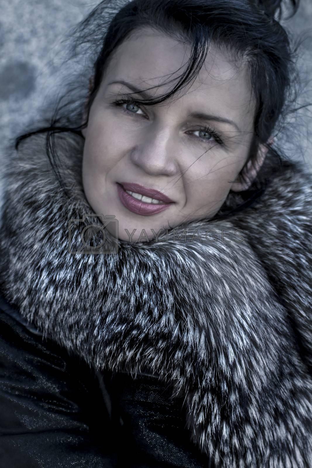 Brunette.Beautiful woman in winter.Beauty Fashion Model Girl in a Fur Hat. Russian Stylish young.Portrait.