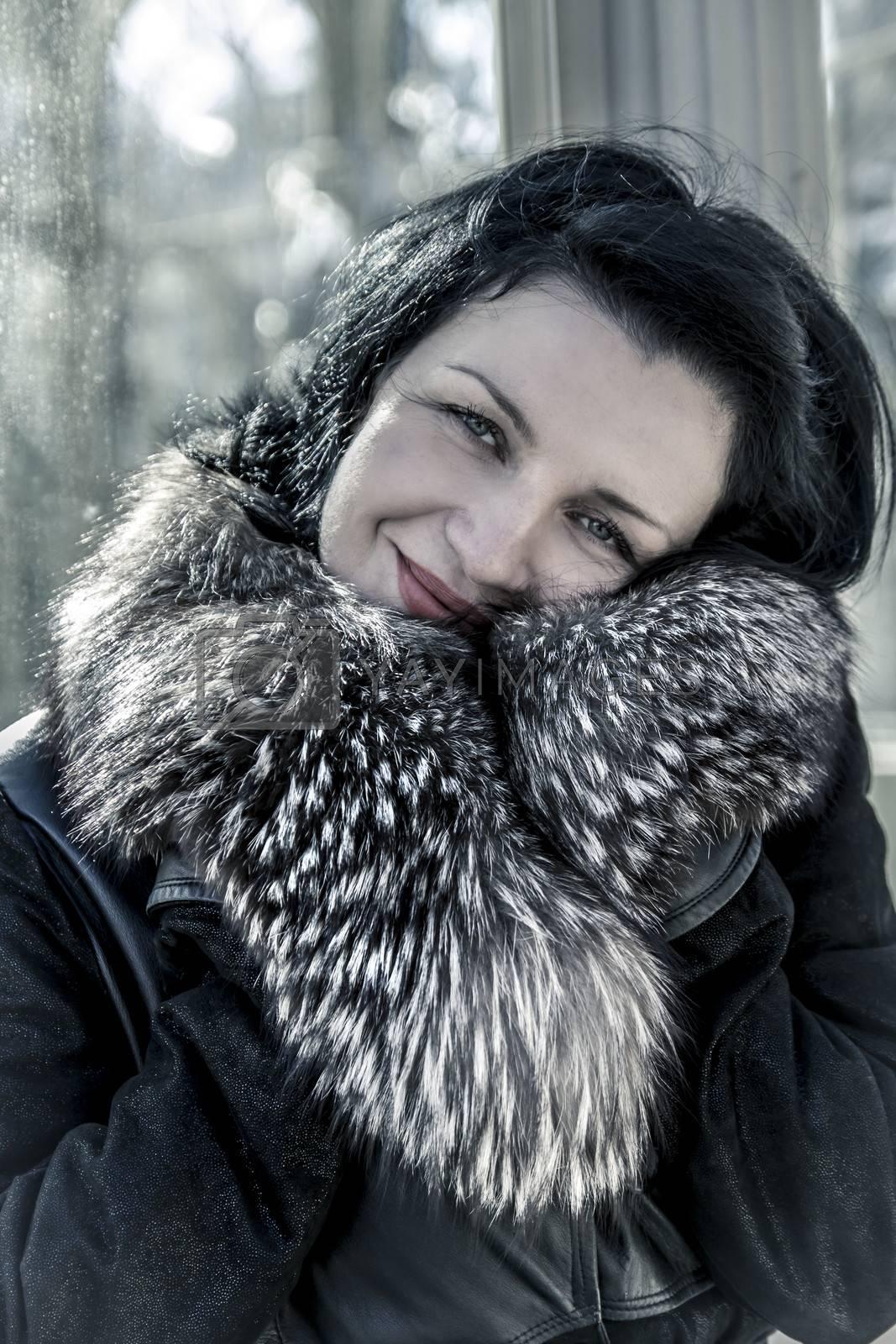 Luxury.Beautiful woman in winter.Beauty Fashion Model Girl in a Fur Hat. Russian Stylish young.Portrait.