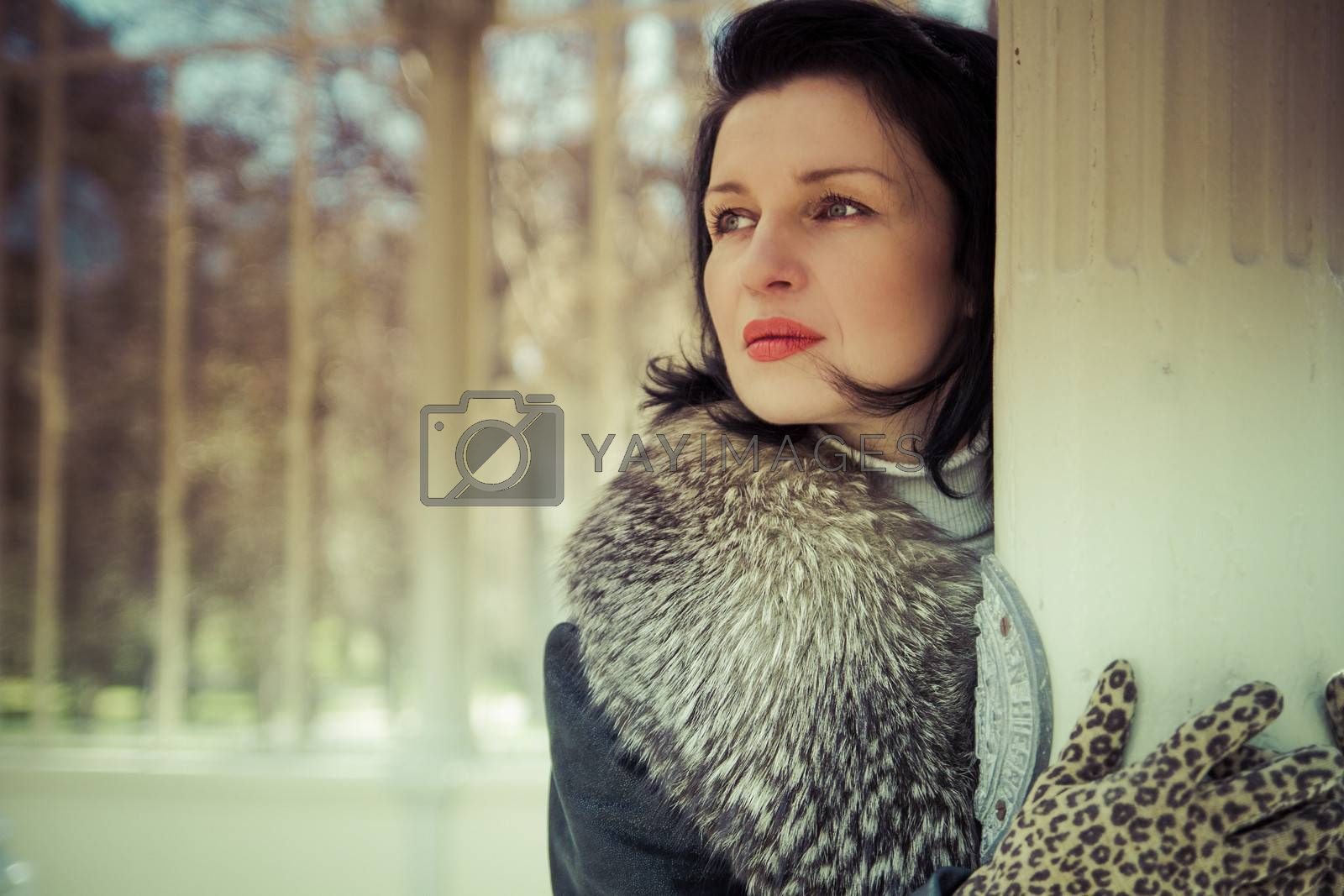 Palace.Beautiful woman in winter.Beauty Fashion Model Girl in a Fur Hat. Russian Stylish young.Portrait.