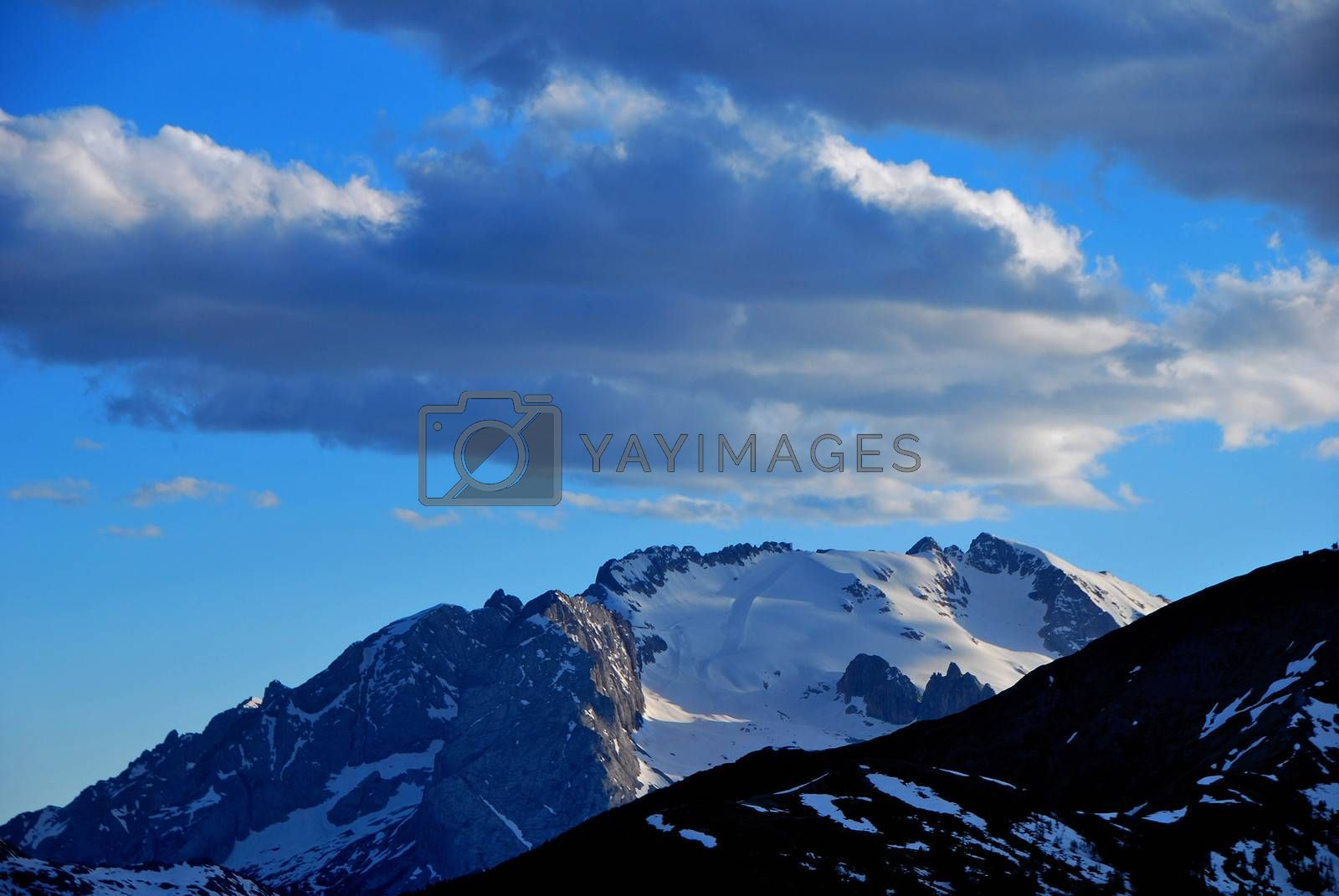 snow covered high mountains and blue sky