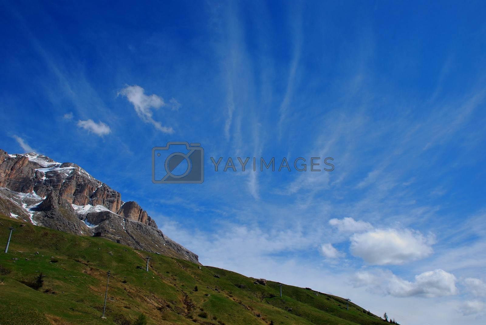 steep mountainside with beautiful sky