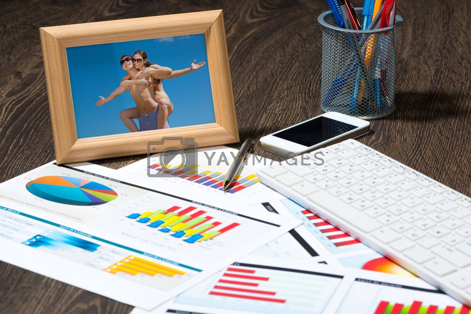 photo frame, business papers with financial charts. Workplace of the businessman.