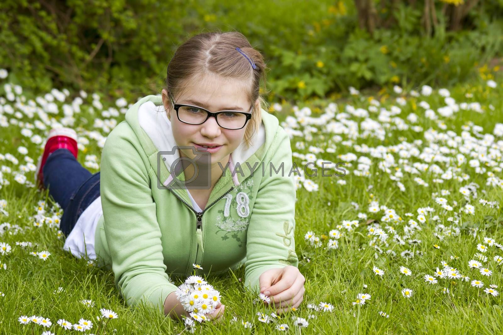 young girl picking daisies by miradrozdowski