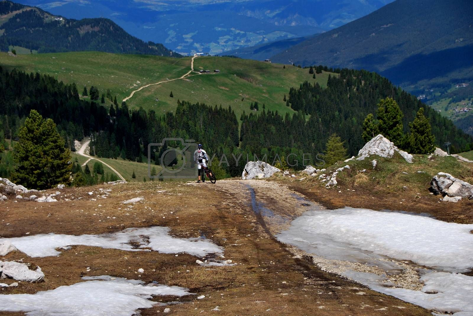 mountain biker before departure in the mountains with snow