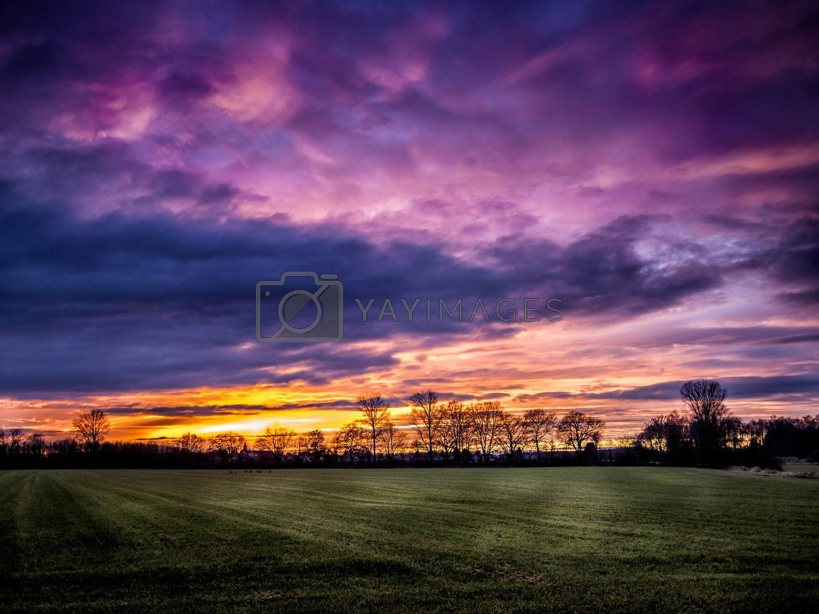 Romantic red clouds over a bavarian landscape at sunset