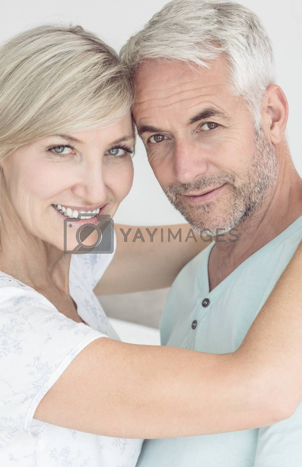 Closeup portrait of a loving mature couple at home