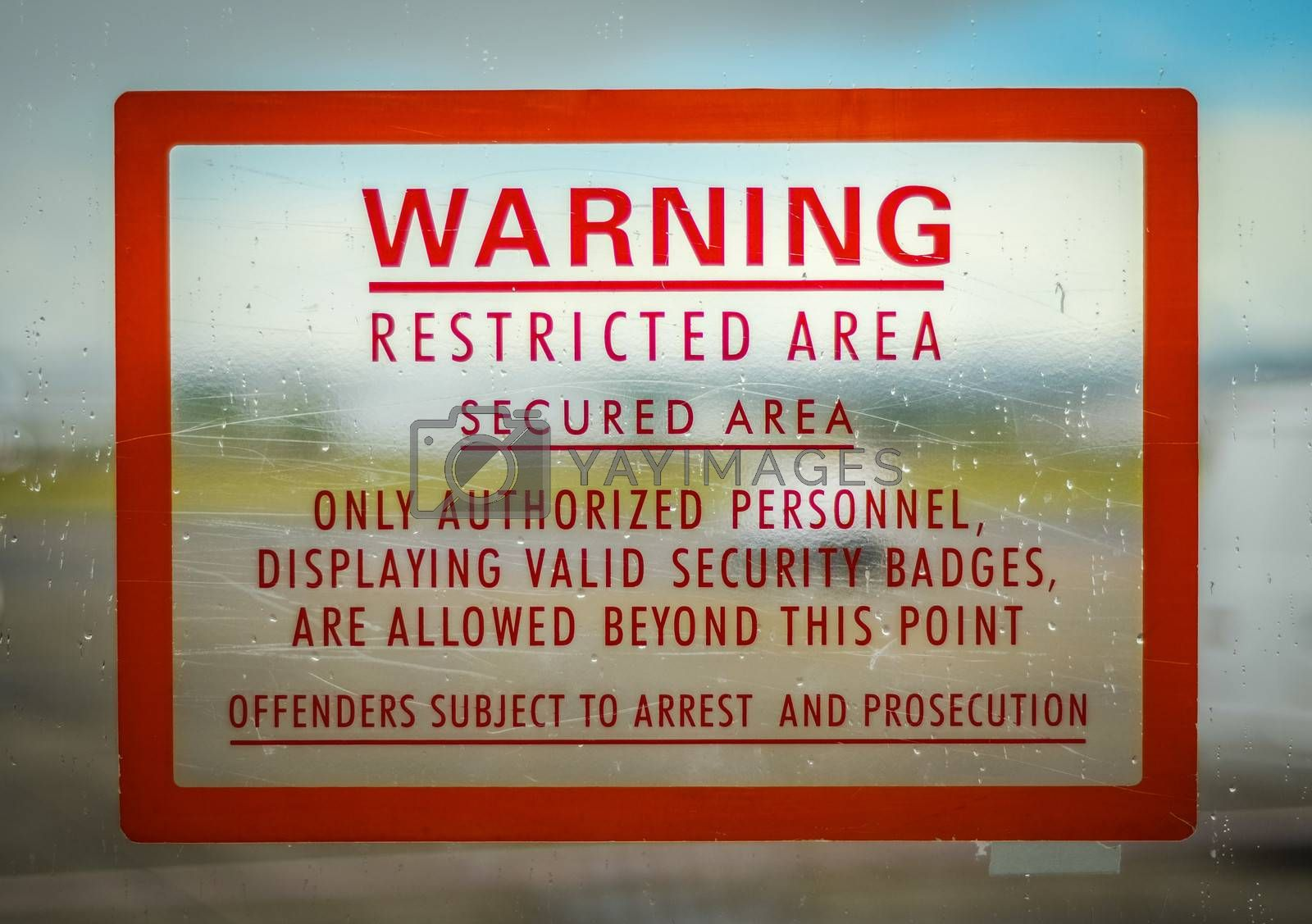 A Red Airport Security Restricted Area Warning Sign