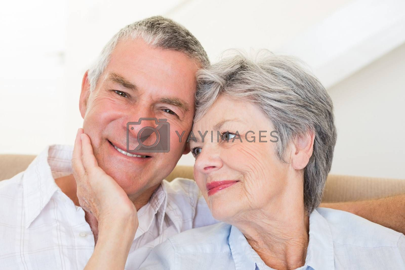 Loving senior woman touching husband at home
