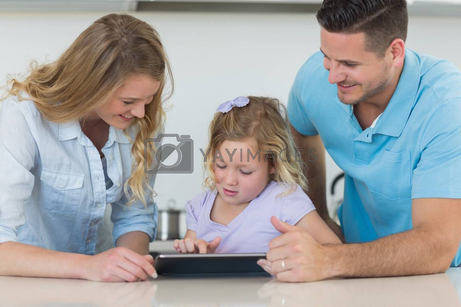 Family using tablet PC at table by Wavebreakmedia