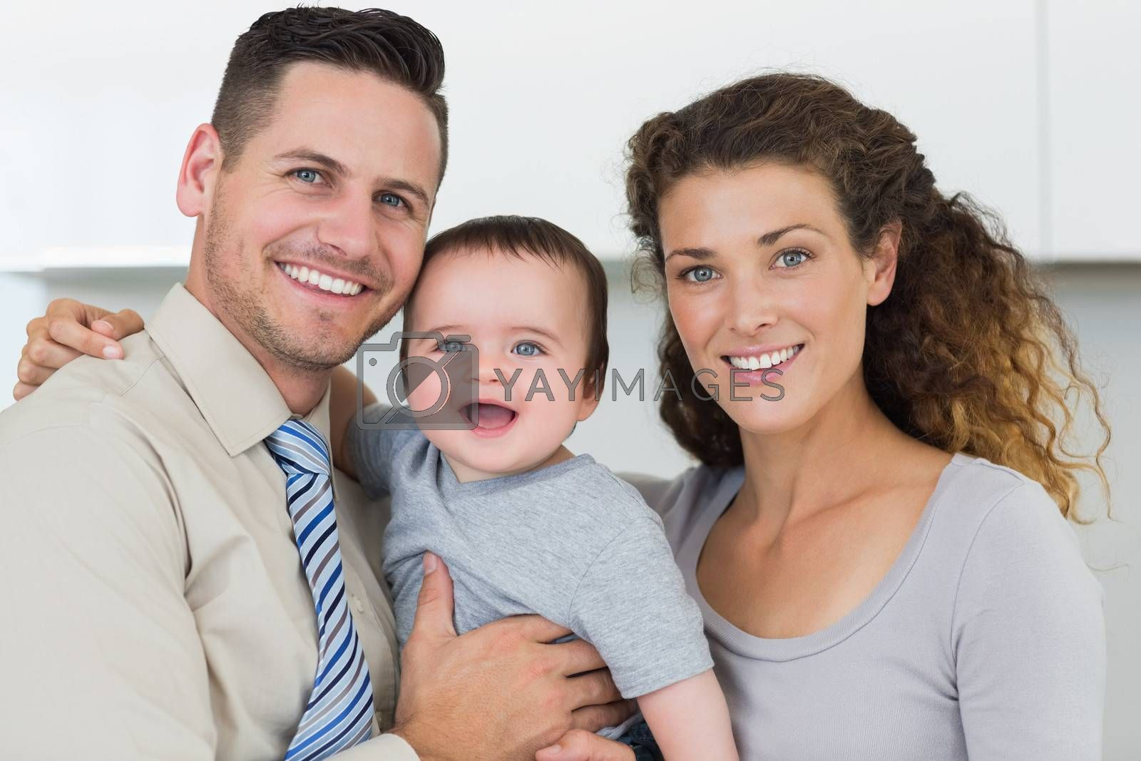 Portrait of smiling parents with adorable baby boy at home