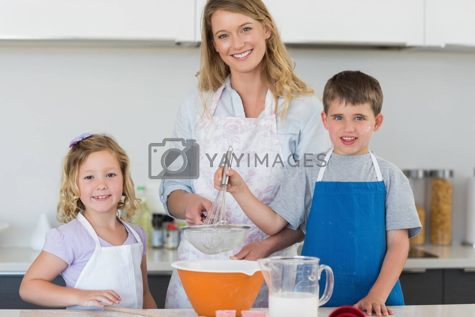 Family baking cookies at counter top by Wavebreakmedia