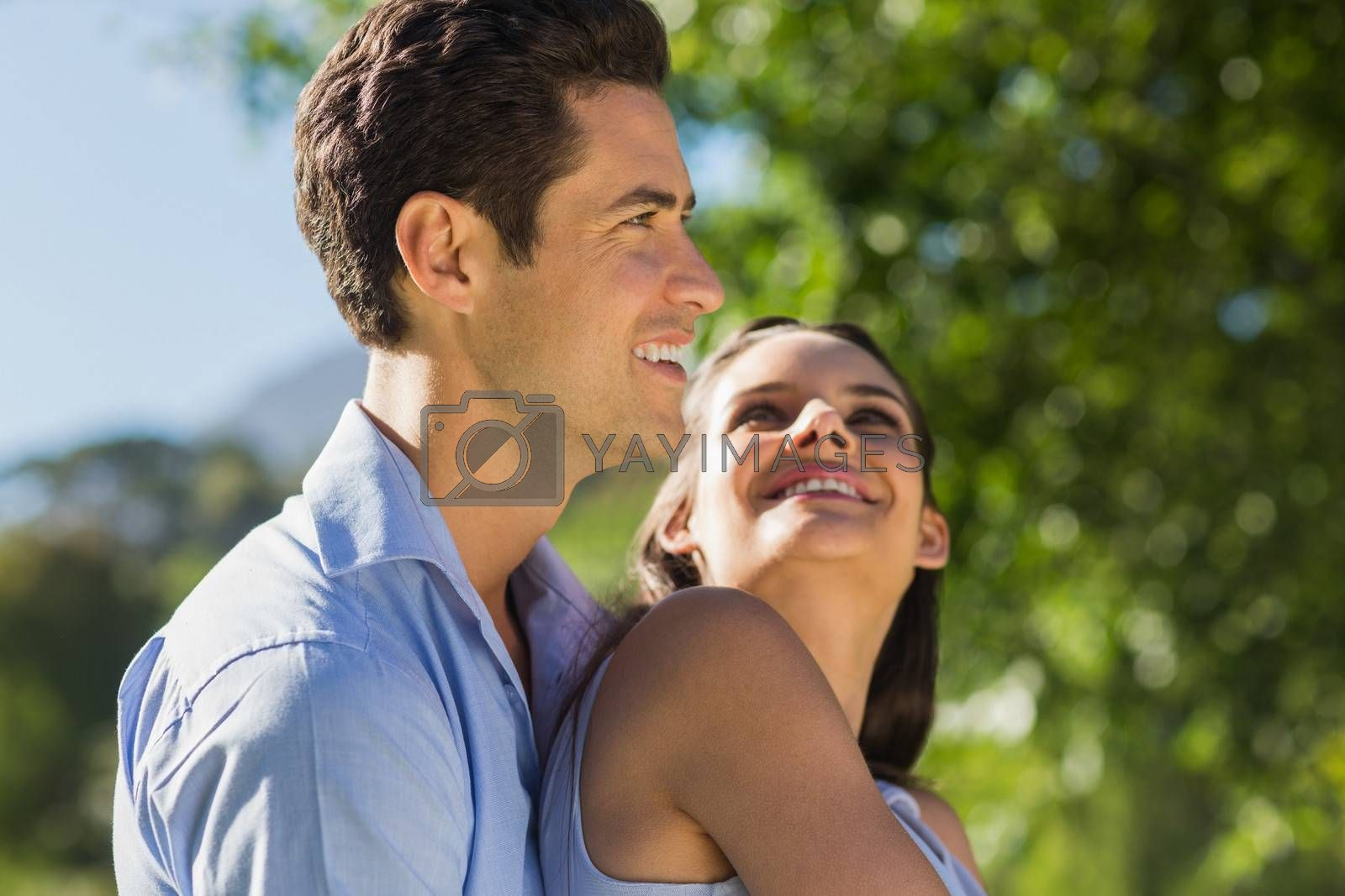 Side view of a loving and happy young couple at the park