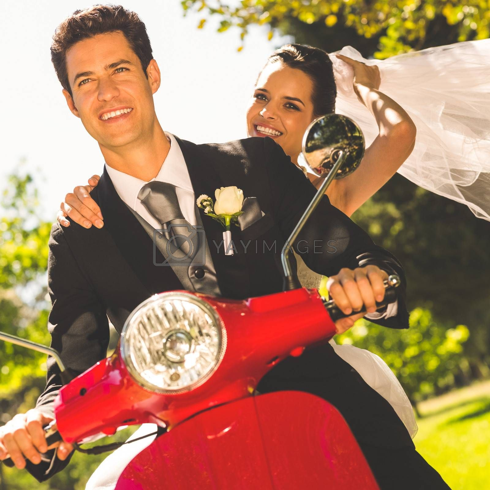 Portrait of a newlywed couple enjoying scooter ride
