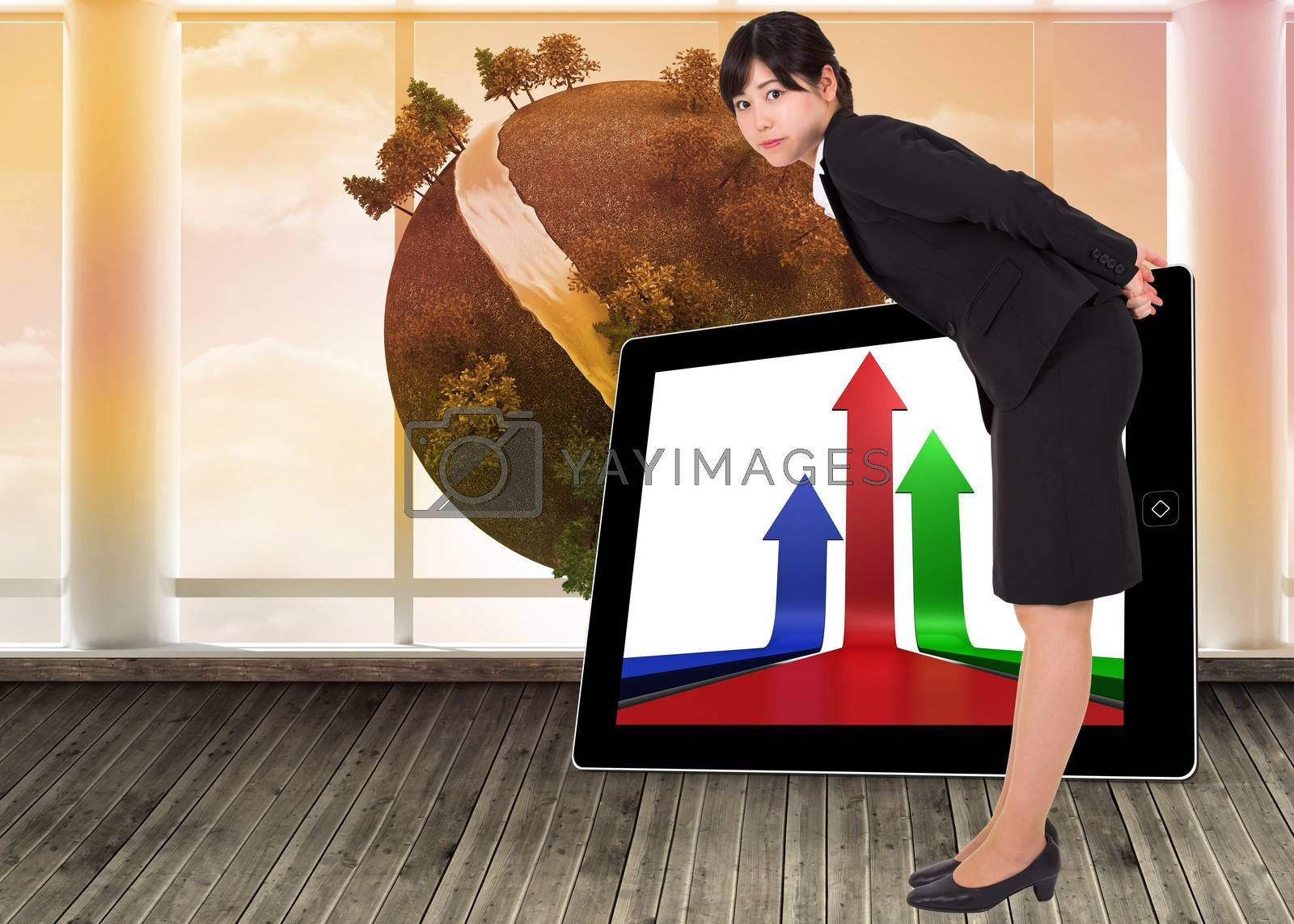 Serious businesswoman bending against digital earth floating in room