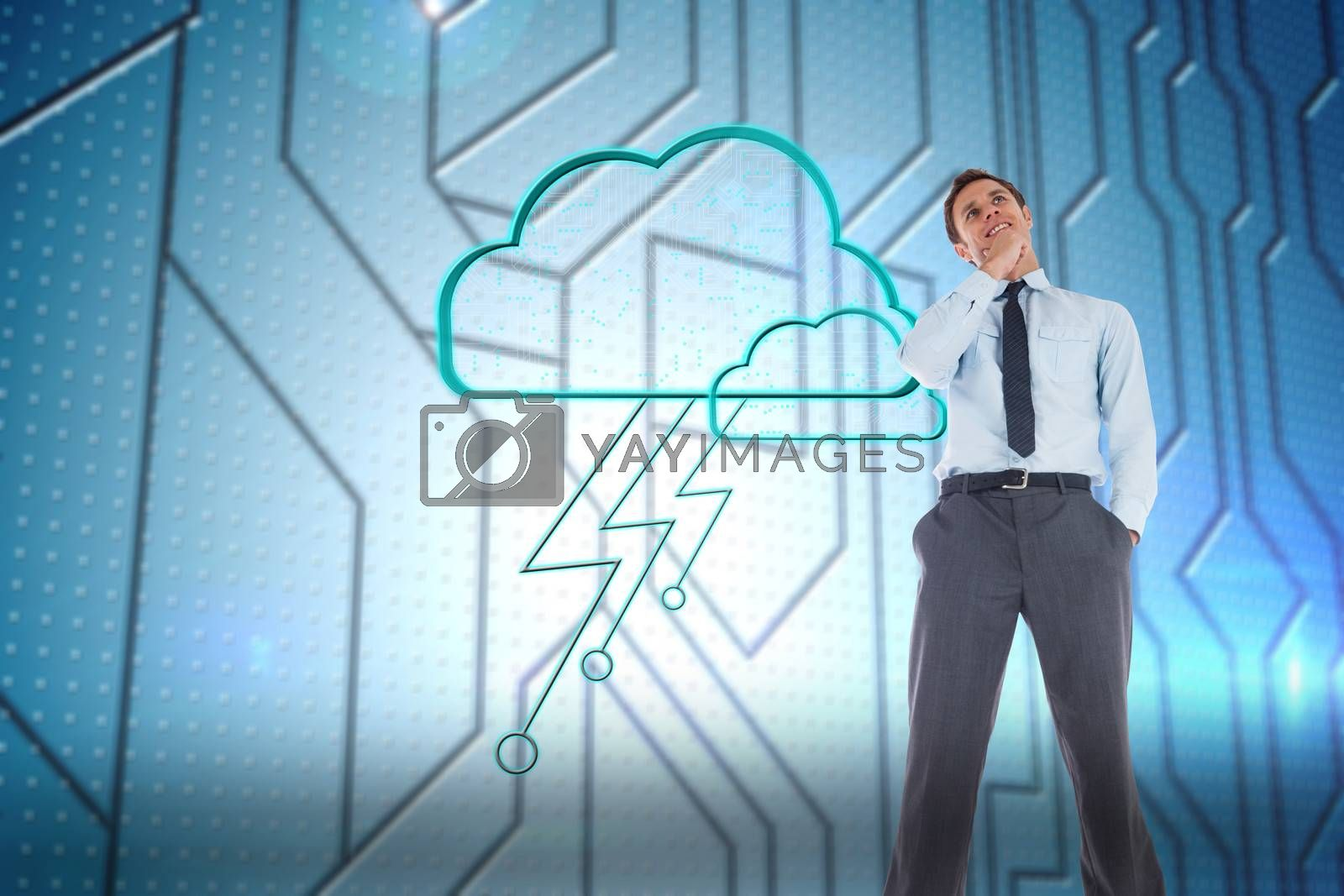 Thoughtful businessman with hand on chin against circuit board on futuristic background