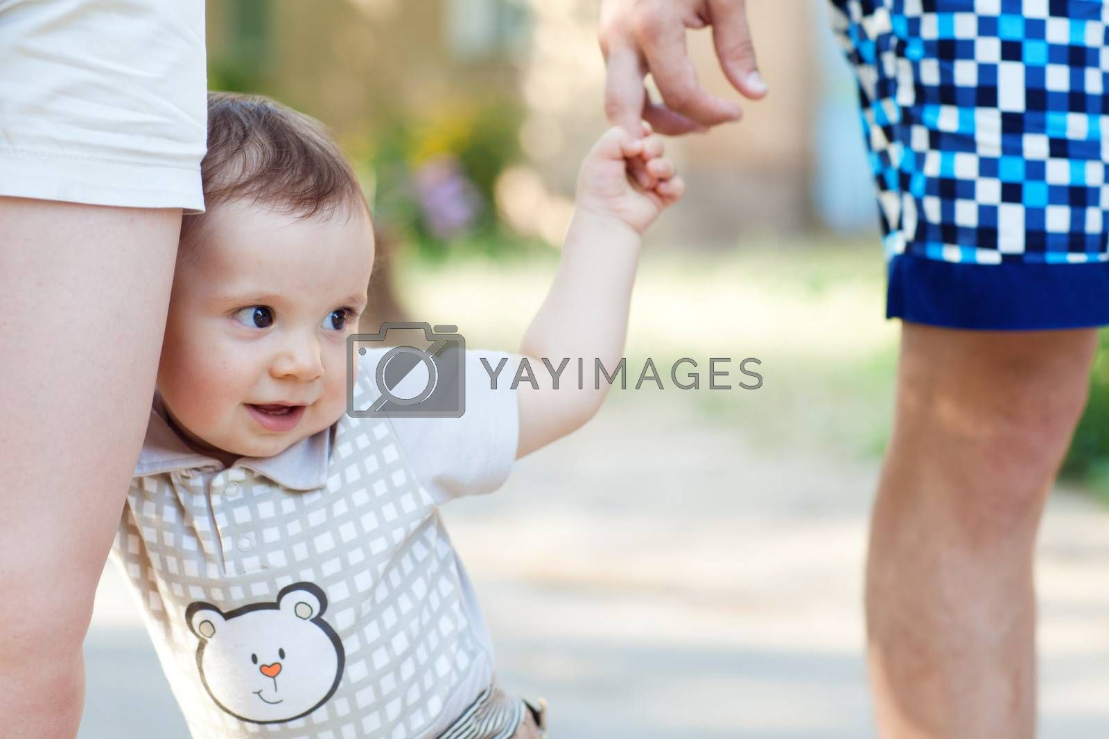 child with mom and dad walking