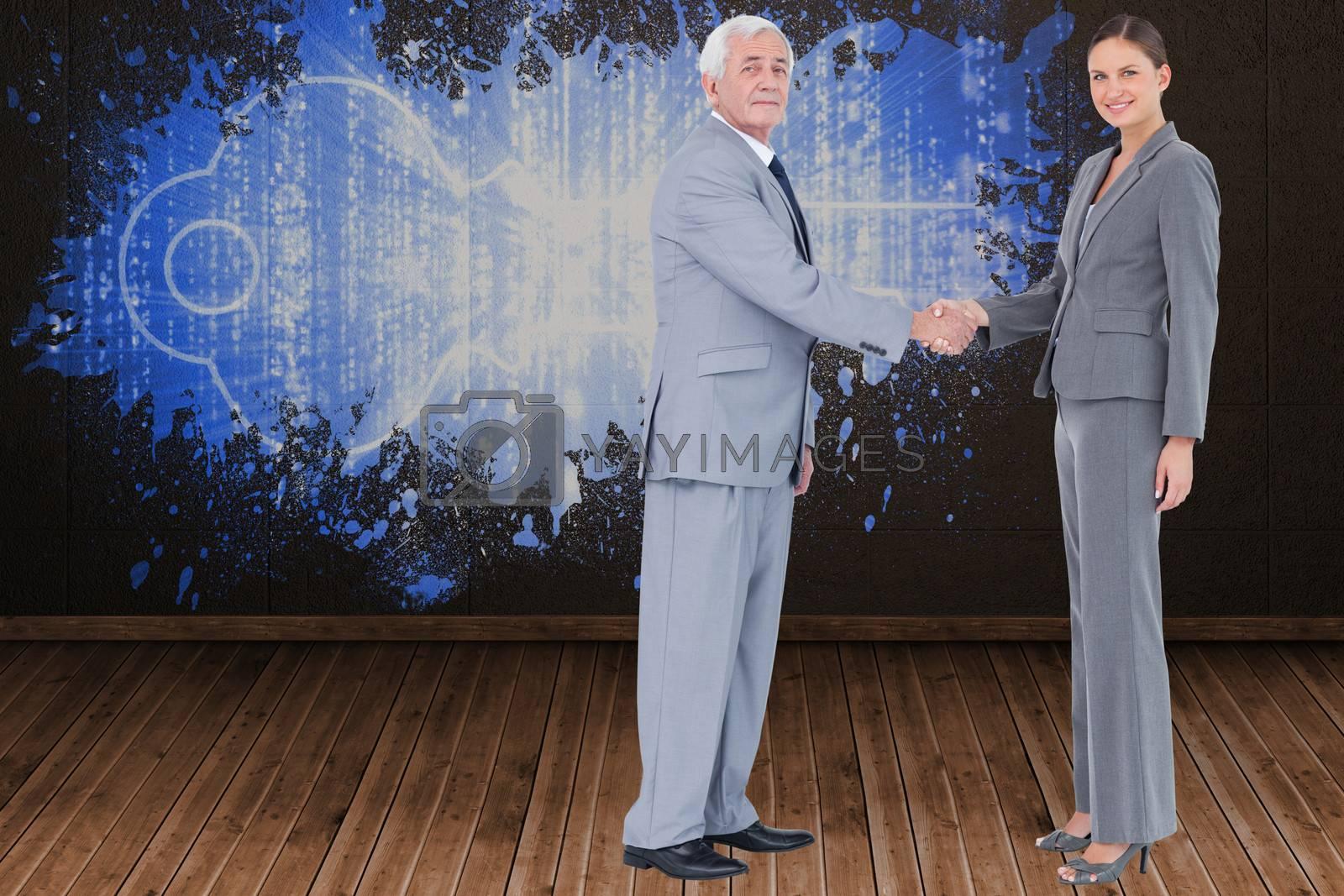 Businessman and woman shaking hands against splash on wall revealing digital key
