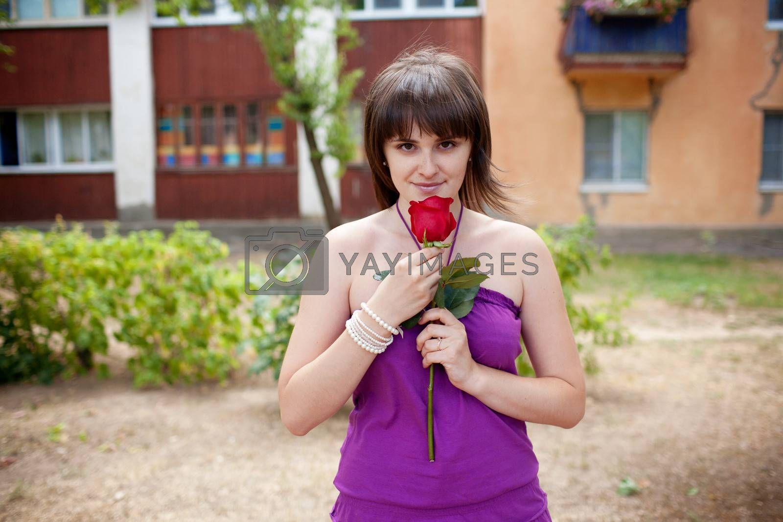 girl with red rose outdoor