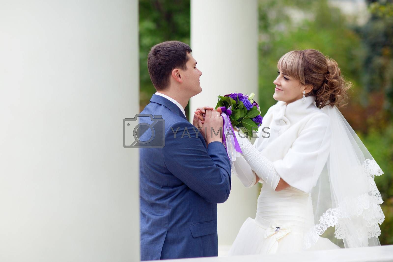couple near the columns