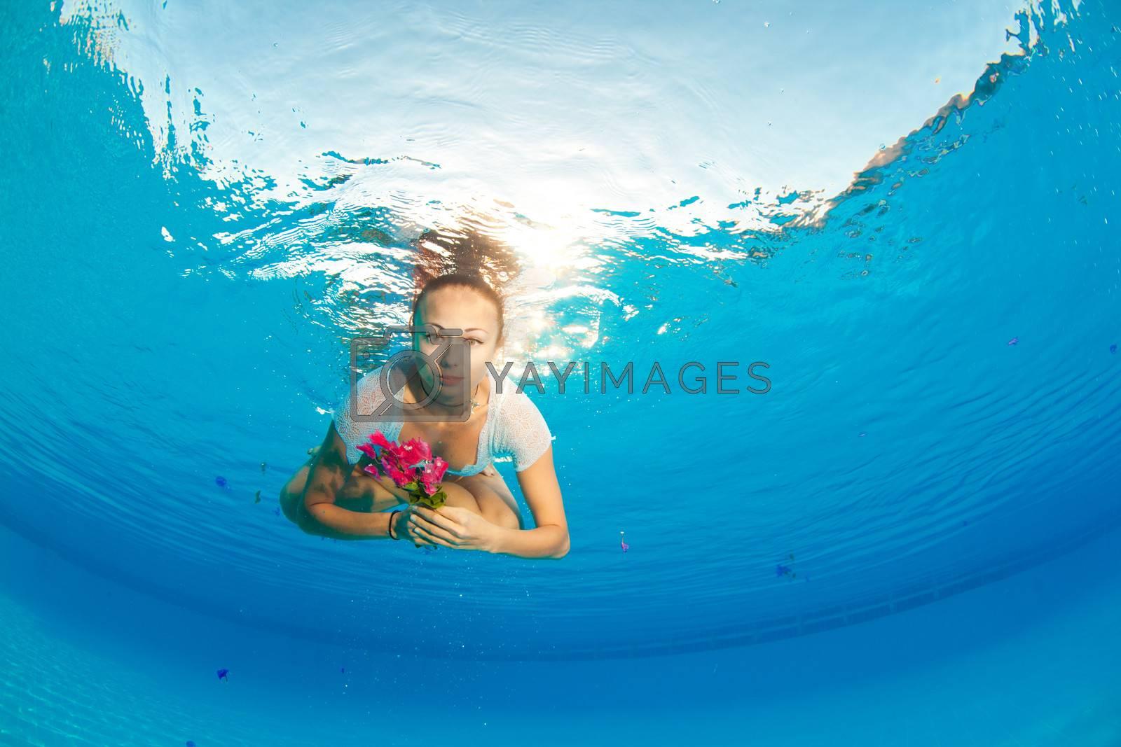 underwater portrait with flower