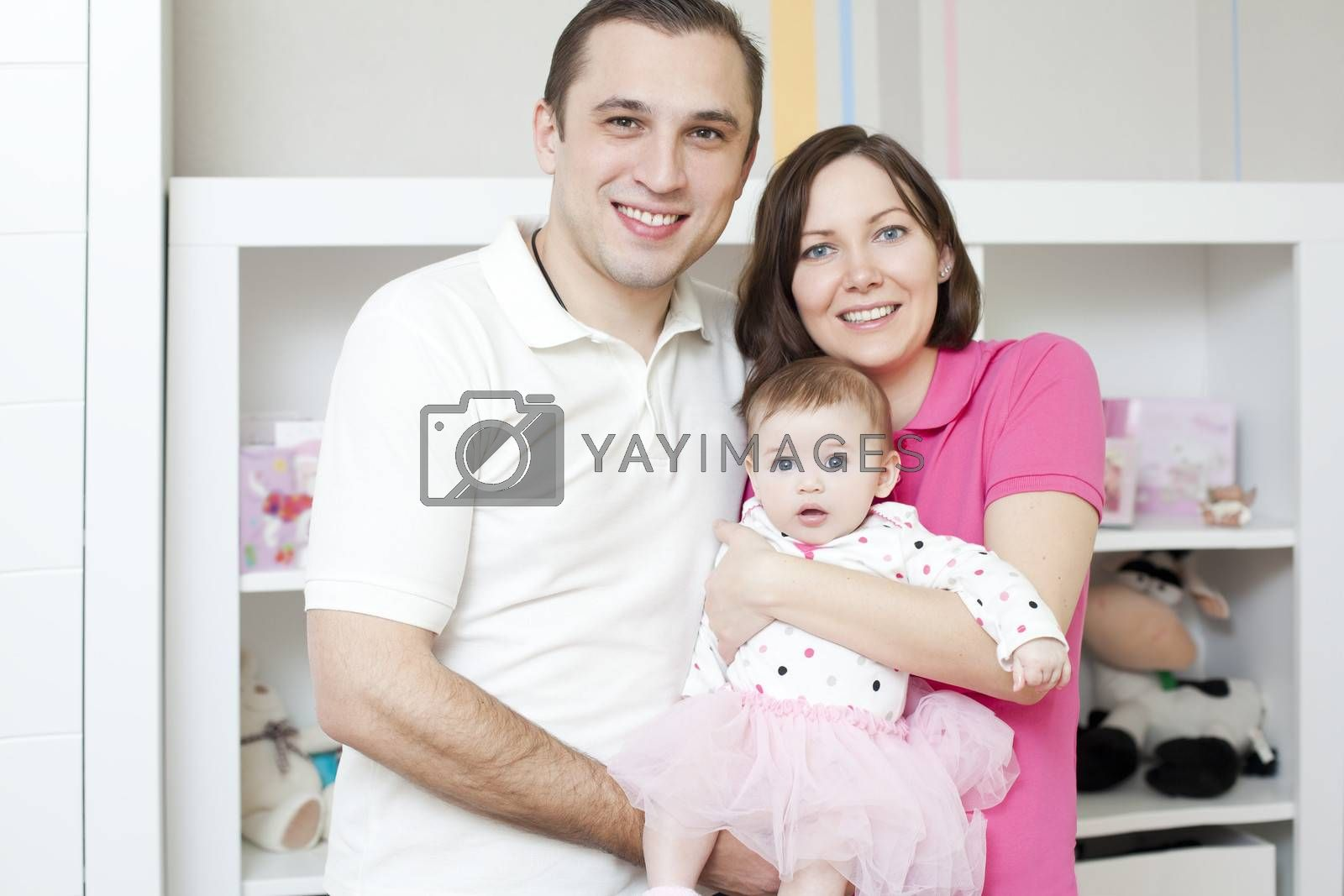 Happy family at home mother and father holding their young ballet dancer