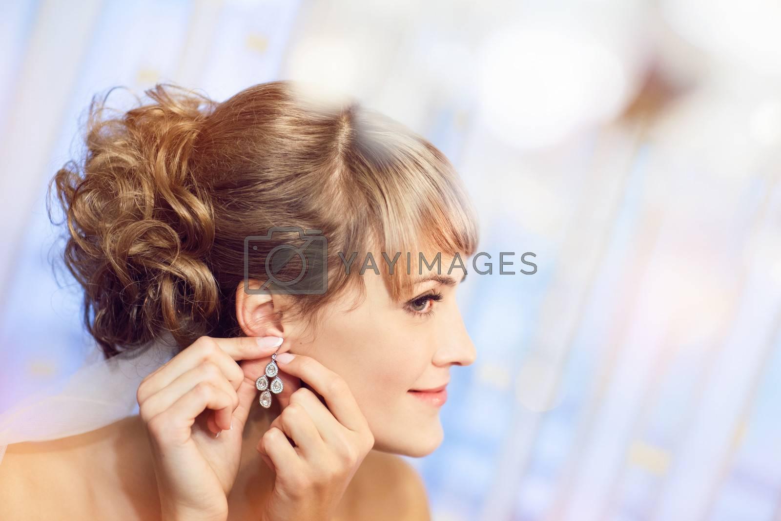 girl puts on an earring