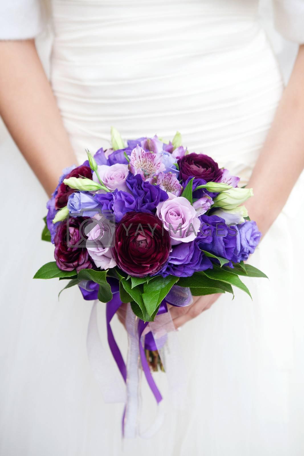 hands on wedding bouquet