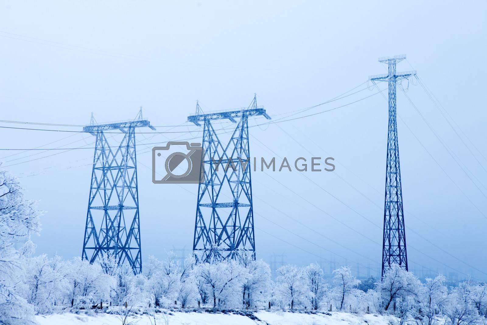 Electrical high-voltage metal pillars in winter