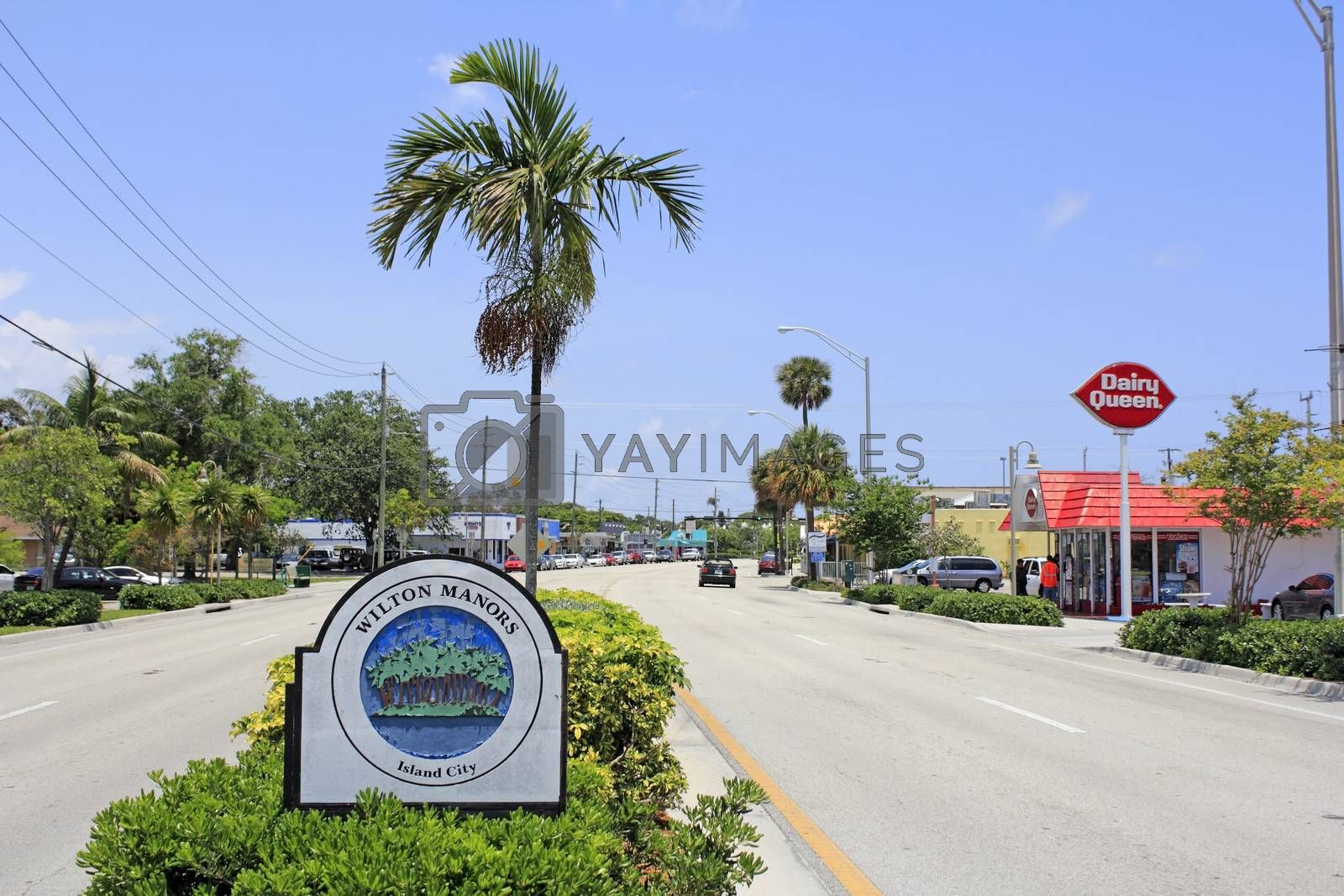 WILTON MANORS, FLORIDA - MAY 11, 2013: Sign that says Wilton Manors and Island City with palm trees on an island graphic in the median of Wilton Drive in this urban city of 11,9995 in 2012.