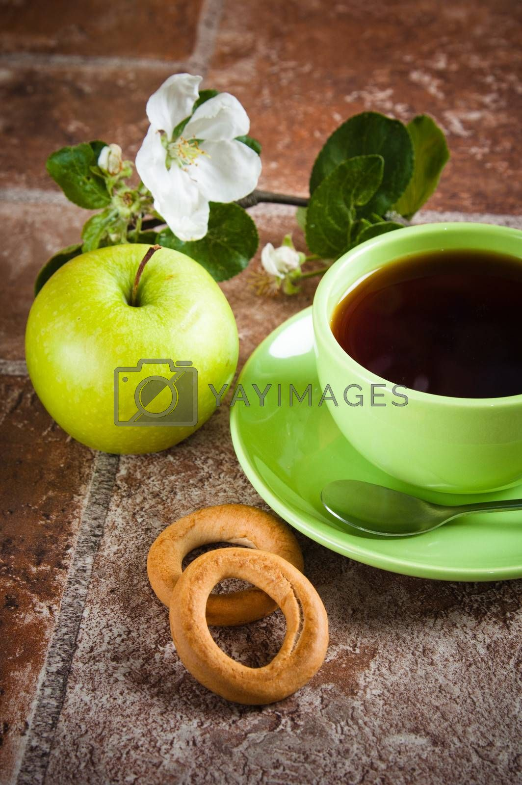 Cup of tea with an apple