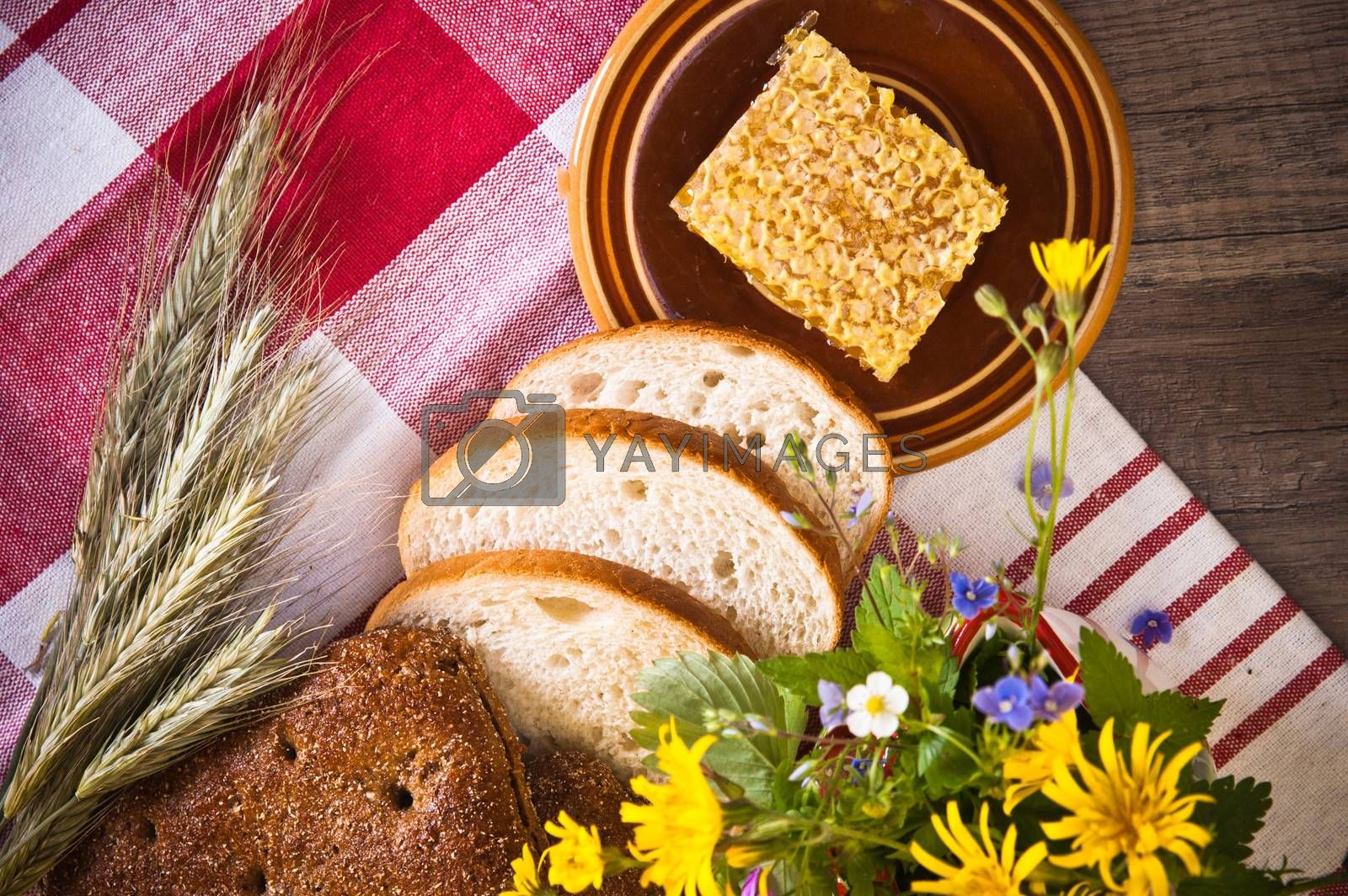 Still life with honeycombs, flowers and pot